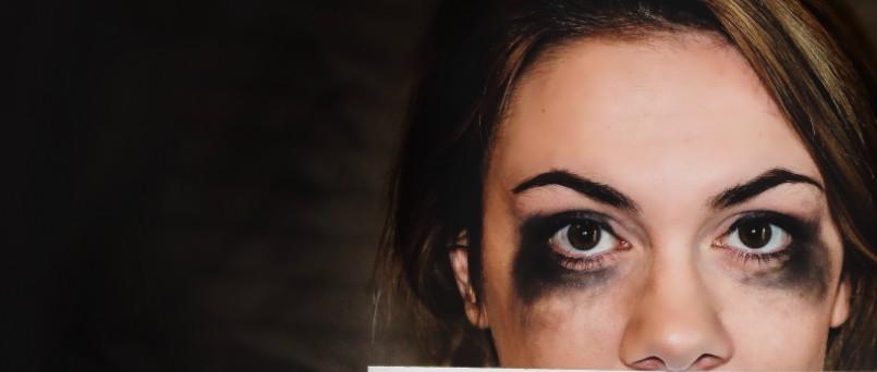 girls face with black makeup